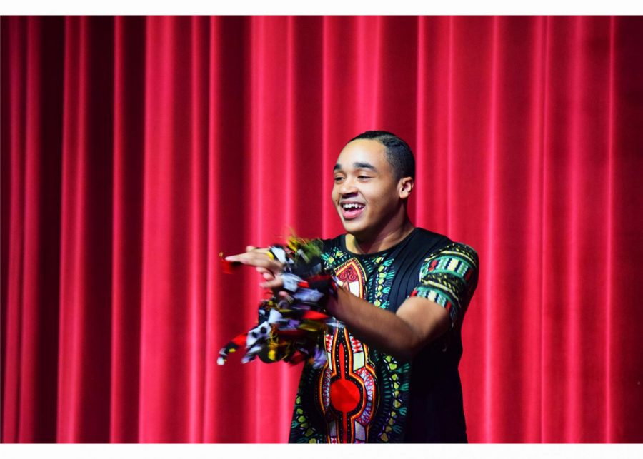 A performer from the Epiphany Dance Collective presents traditional Western African dancing in the auditorium.