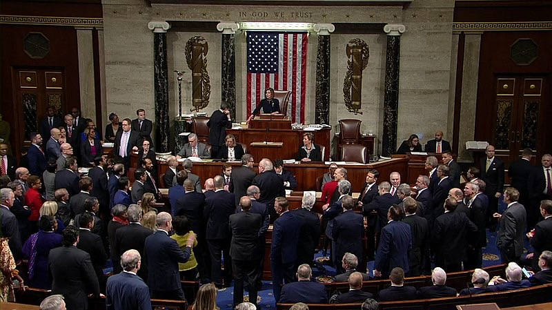 Congressmen on Dec. 18 in the House of Representatives discuss voting on articles of impeachment after allegations of misconduct made against President Trump.