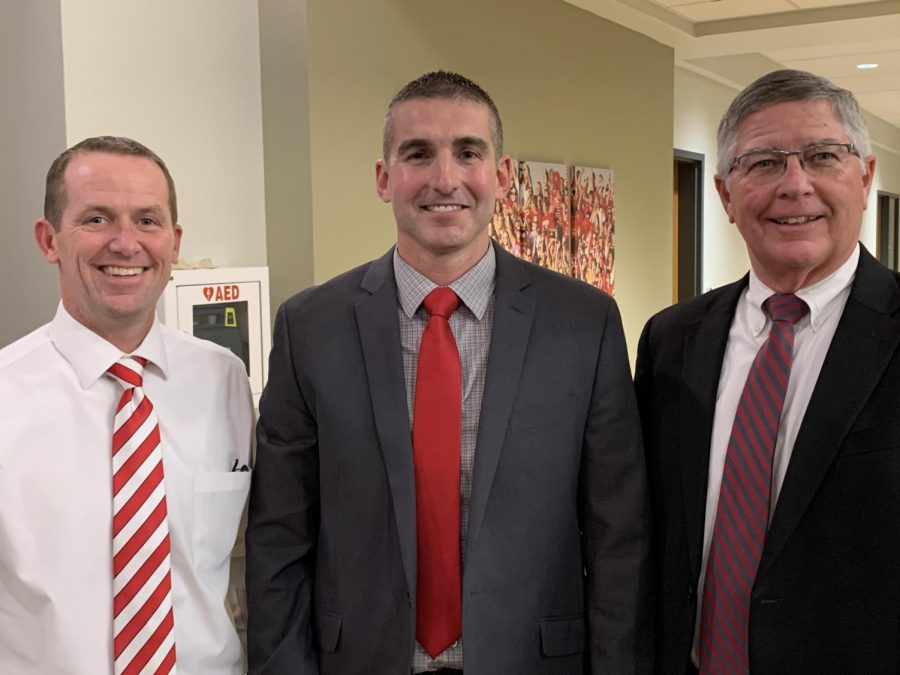 From the left, Robert Seymour, Coach Curt Funk and James Brown take a photo together after Funk was approved as the new head football coach. Photo used with permission of Principal Jason Urban.