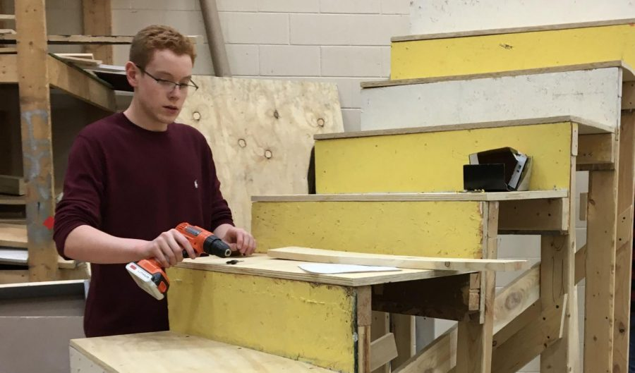 On Jan. 28, freshman Zach McEwen works on adding bracing to his curved stairs to add stability.