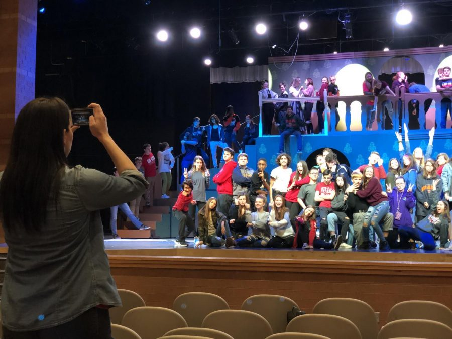 Cast and crew pose for a photo in the auditorium on Mar. 16 before beginning the month long break from school.