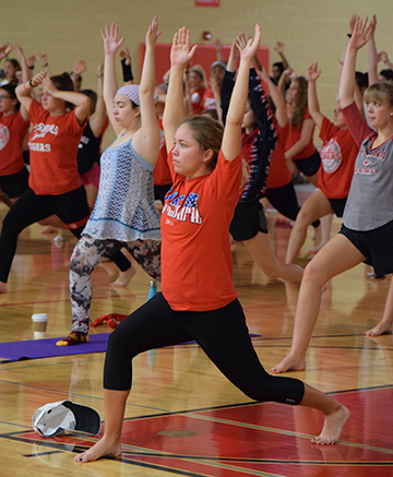 Students participate in a yoga class during student choice day in 2017.