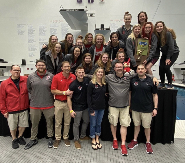 The girls swimming and diving team stands on the podium after finishing runner-up at the 2020 IHSAA State Championship at the IUPUI Natatorium on Feb. 15, 2020.
