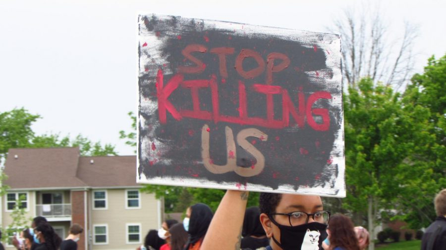 A protester holds up a sign at the protest on June 1. which took place at the Nickel Plate Amphitheater in Fishers.