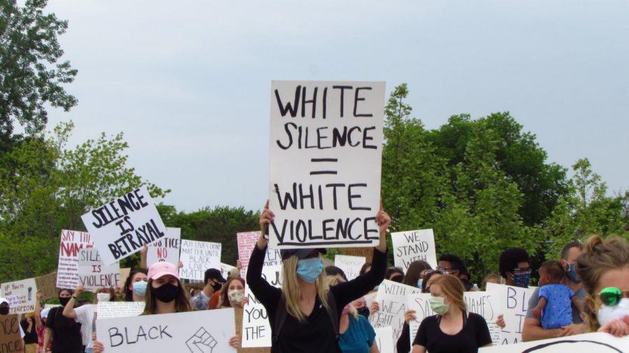 Signs reading phrases similar to White silence = white violence were seen ll throughout the grounds of the protest.