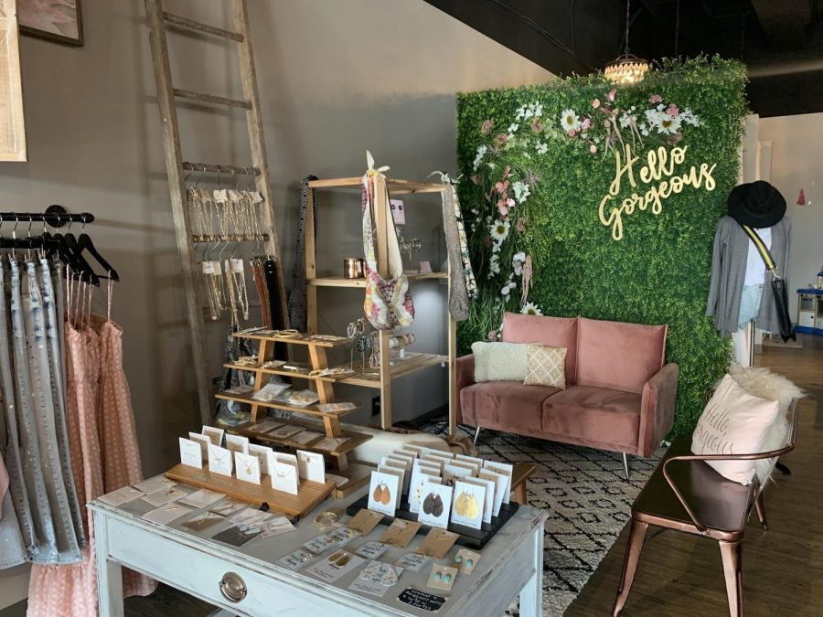 """The sitting area in the boutique awaits customers with the changing room behind the """"Hello Gorgeous"""" wall on Sept 9."""