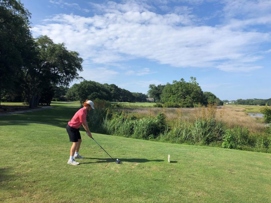 Junior Evan Myers gets ready to hit a tee shot at the Ironwood Country Club golf course.
