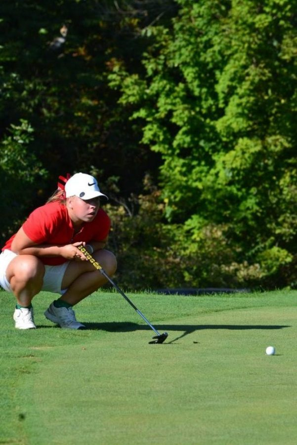 McVay eyes the lie of her ball on the green before a putt on Aug. 21.