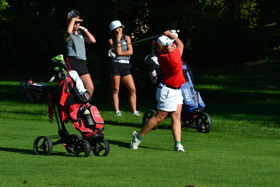 Junior Lillian McVay tees up during the girls golf meet on Aug. 21.