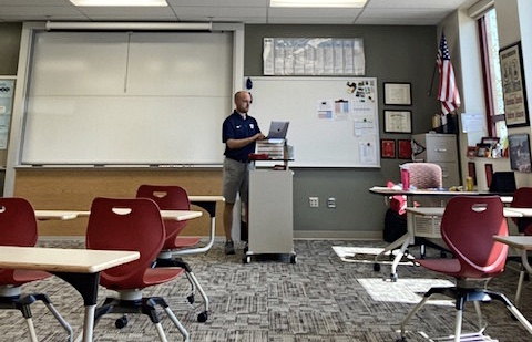During office hours on Sept. 9, Matthew Stahl finishes up work towards the end of the school day at his podium in his empty classroom.
