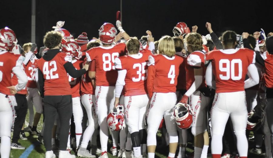 The football team celebrates their victory against Hamilton Southeastern at the first round of sectionals on Oct. 31. The Tigers won 34-29.