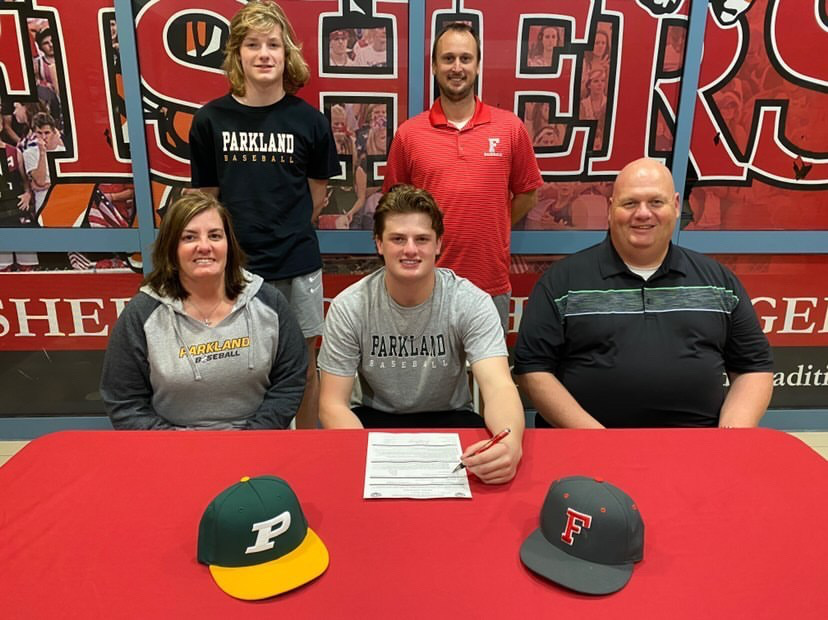 Senior Mason Sweeney signs to play baseball at Parkland College on Nov. 11 in the athletic hallway.