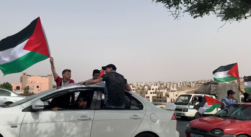 """On May 21, Jordanian civilians participated in a drive-by protest for the freedom of Palestine. They held Palestinian flags, honked their horns, chanted """"Free free Palestine"""" and blasted traditional Palestinian music."""