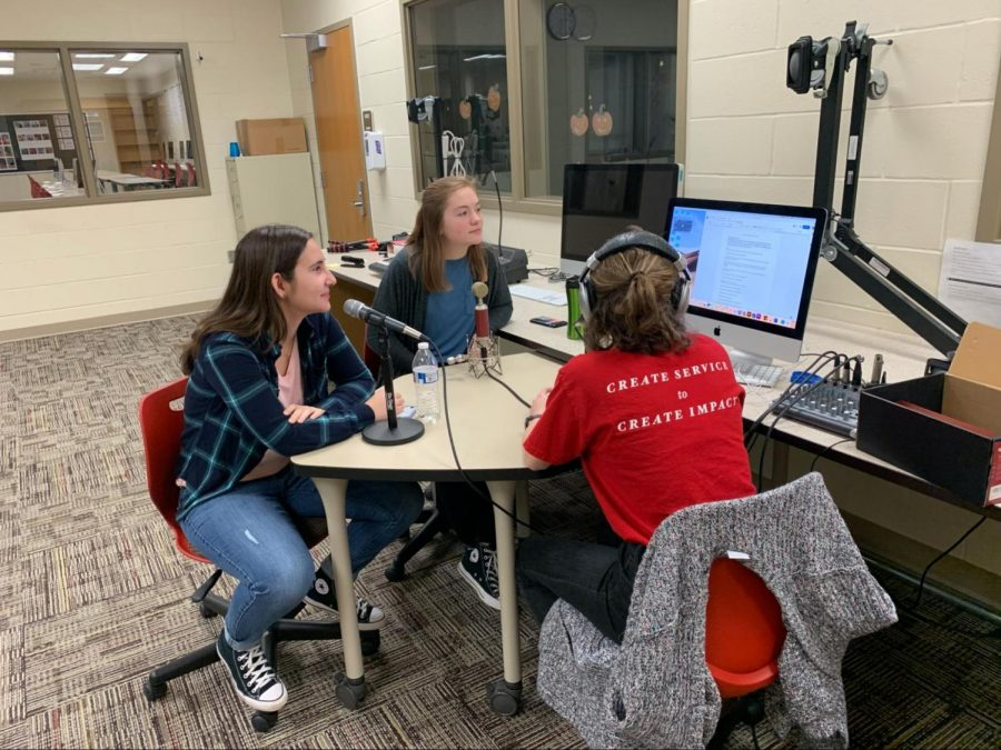 Seniors Isabella Schott and Izzy Alexander record an episode of You Broke It. Let's Fix It. with guest senior Meg Gibson.