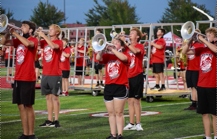Marching band members run through their piece in preparation for their performance.