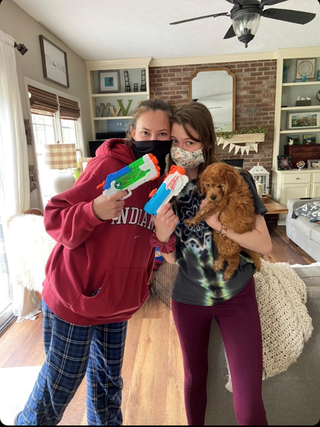 Seniors Janie Vanoverwalle and Alexis Howard take the traditional post-elimination picture after Vanoverwalle eliminated Howard at her house on April 29.