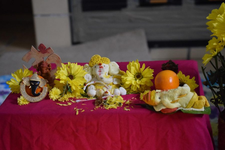 The idol of Lord Ganesha, along with flowers, fruits and other offerings sit on a table at sophomore Sravani Katurus house on Sept. 10.