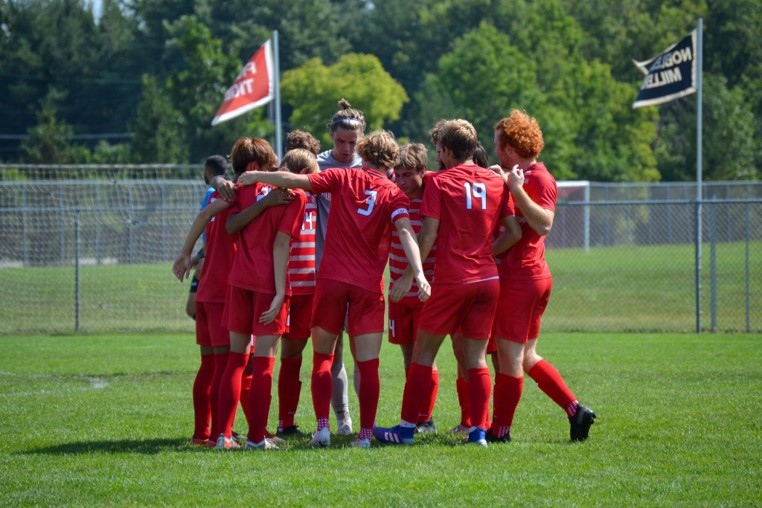 """Starting players huddle up before the beginning of the match. """"It feels great to be freshman on varsity especially with this group of boys on the team. They make it seem like I'm not a freshman."""" freshman Caleb Hernandez said. FHS defeated McCutcheon High School 4-0."""