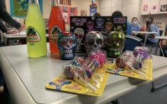 Michelle Helmkamp and Stephanie Gutting give out traditional Hispanic treats as prizes to the winners of the games.