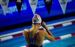 Ramey adjusts her goggles on June 16th, 2021 at the Olympic Trials in Omaha, Nebraska. Ramey finished in the top eight at the Trials.