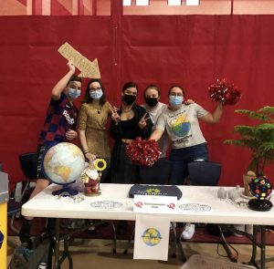 Sophomore Jack Moriarty, seniors Grace Moriarty, Sydney Britt and Sofia Villalta pose for a photo for Environmental Club's Instagram after hosting a booth at the school club fair on Aug. 19.